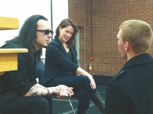Damien Echols along with his douche goggles and douche beard with their lovely wife, The Joker.